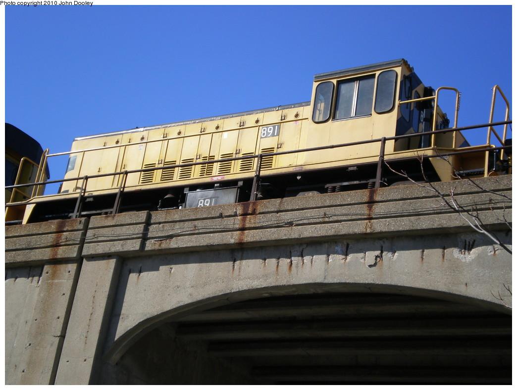 (212k, 1044x788)<br><b>Country:</b> United States<br><b>City:</b> New York<br><b>System:</b> New York City Transit<br><b>Line:</b> IND Rockaway<br><b>Location:</b> Beach 90th Street/Holland <br><b>Route:</b> Work Service<br><b>Car:</b> R-77 Locomotive  891 <br><b>Photo by:</b> John Dooley<br><b>Date:</b> 3/6/2010<br><b>Viewed (this week/total):</b> 2 / 569