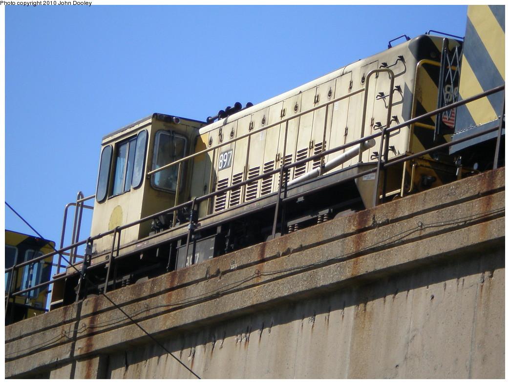 (240k, 1044x788)<br><b>Country:</b> United States<br><b>City:</b> New York<br><b>System:</b> New York City Transit<br><b>Line:</b> IND Rockaway<br><b>Location:</b> Beach 90th Street/Holland <br><b>Route:</b> Work Service<br><b>Car:</b> R-77 Locomotive  897 <br><b>Photo by:</b> John Dooley<br><b>Date:</b> 3/6/2010<br><b>Viewed (this week/total):</b> 0 / 569