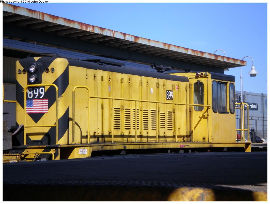 (214k, 1044x788)<br><b>Country:</b> United States<br><b>City:</b> New York<br><b>System:</b> New York City Transit<br><b>Line:</b> IND Rockaway<br><b>Location:</b> Beach 90th Street/Holland <br><b>Route:</b> Work Service<br><b>Car:</b> R-77 Locomotive  899 <br><b>Photo by:</b> John Dooley<br><b>Date:</b> 3/6/2010<br><b>Viewed (this week/total):</b> 0 / 593
