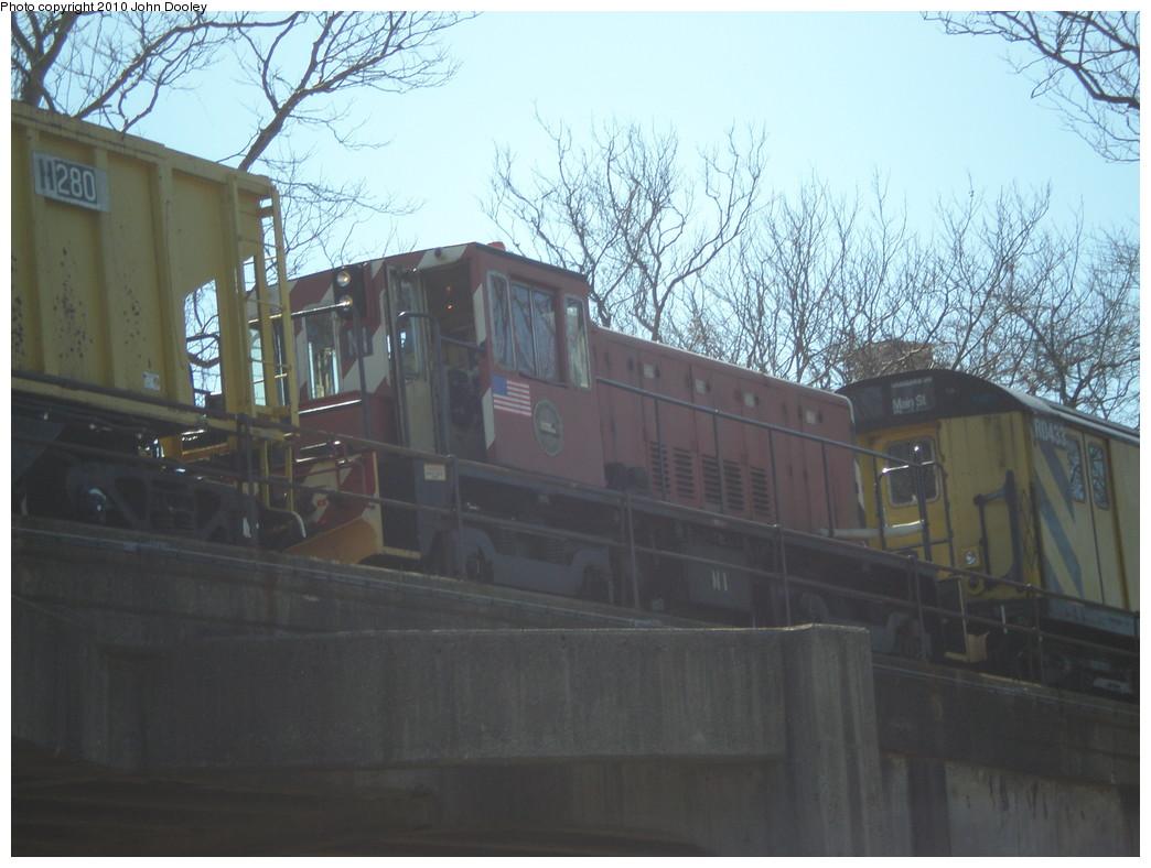 (203k, 1044x788)<br><b>Country:</b> United States<br><b>City:</b> New York<br><b>System:</b> New York City Transit<br><b>Line:</b> IND Rockaway<br><b>Location:</b> Beach 90th Street/Holland <br><b>Route:</b> Work Service<br><b>Car:</b> R-47 (SBK) Locomotive  N1 <br><b>Photo by:</b> John Dooley<br><b>Date:</b> 3/6/2010<br><b>Viewed (this week/total):</b> 4 / 721