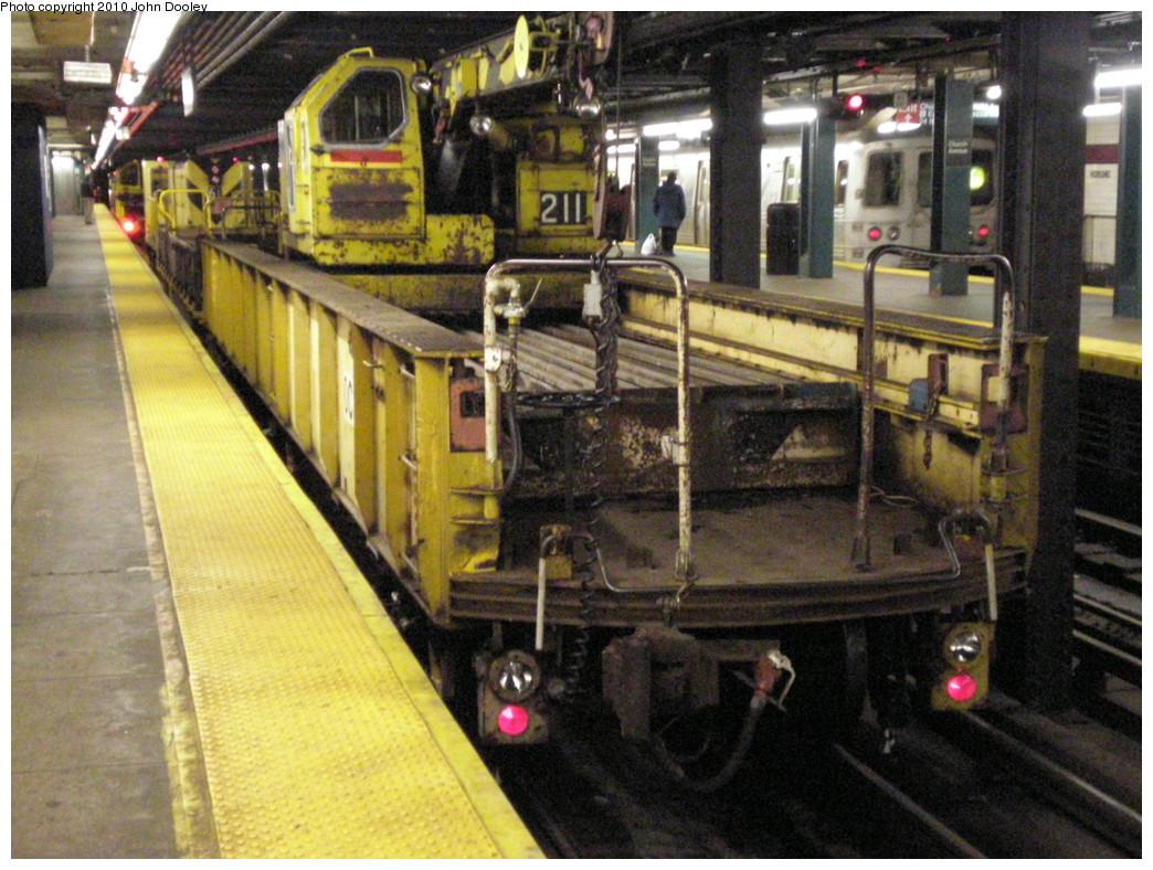 (267k, 1044x788)<br><b>Country:</b> United States<br><b>City:</b> New York<br><b>System:</b> New York City Transit<br><b>Line:</b> IND Crosstown Line<br><b>Location:</b> Church Avenue <br><b>Route:</b> Work Service<br><b>Car:</b> R-61 Telescoping Boom Crane (Fuji, 1982)  211 <br><b>Photo by:</b> John Dooley<br><b>Date:</b> 3/13/2010<br><b>Viewed (this week/total):</b> 2 / 936