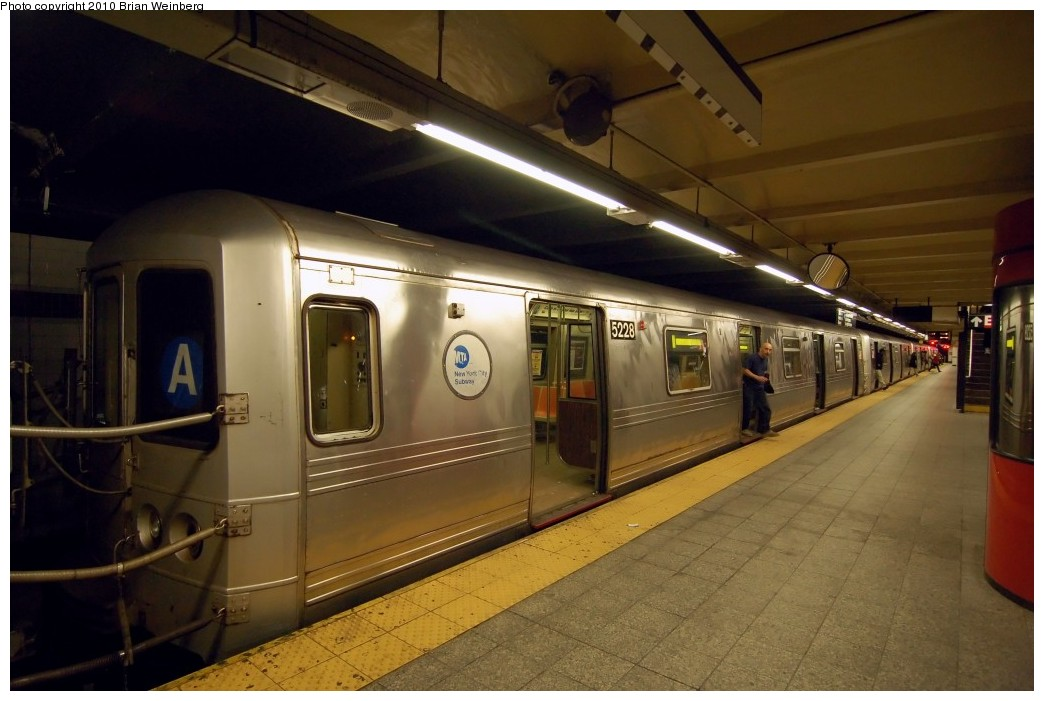 (216k, 1044x701)<br><b>Country:</b> United States<br><b>City:</b> New York<br><b>System:</b> New York City Transit<br><b>Line:</b> IND 8th Avenue Line<br><b>Location:</b> 207th Street <br><b>Route:</b> A<br><b>Car:</b> R-44 (St. Louis, 1971-73) 5228 <br><b>Photo by:</b> Brian Weinberg<br><b>Date:</b> 3/18/2010<br><b>Notes:</b> Note this car has a stainless steel belly band.<br><b>Viewed (this week/total):</b> 1 / 1185
