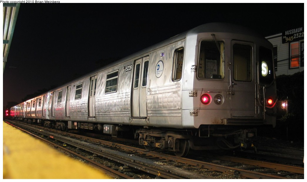 (135k, 1044x621)<br><b>Country:</b> United States<br><b>City:</b> New York<br><b>System:</b> New York City Transit<br><b>Location:</b> Rockaway Park Yard<br><b>Route:</b> A<br><b>Car:</b> R-44 (St. Louis, 1971-73) 5228 <br><b>Photo by:</b> Brian Weinberg<br><b>Date:</b> 7/24/2003<br><b>Notes:</b> Note this car has a stainless steel belly band.<br><b>Viewed (this week/total):</b> 2 / 1166