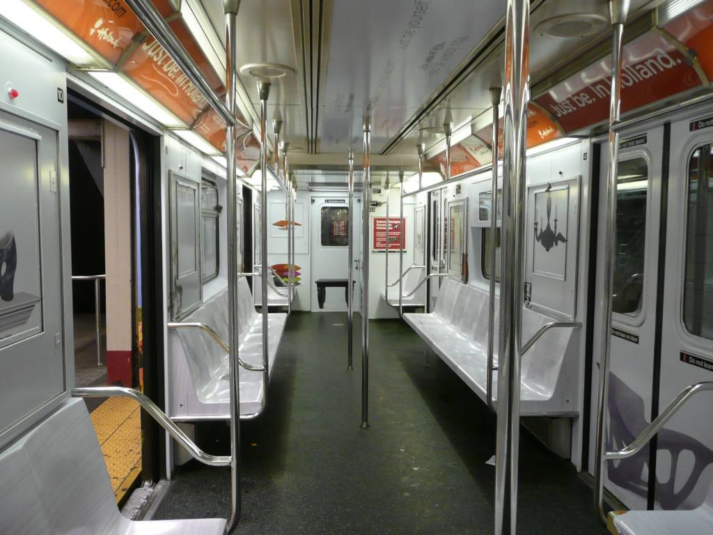 (130k, 1024x768)<br><b>Country:</b> United States<br><b>City:</b> New York<br><b>System:</b> New York City Transit<br><b>Line:</b> IRT Times Square-Grand Central Shuttle<br><b>Location:</b> Times Square <br><b>Route:</b> S<br><b>Car:</b> R-62A (Bombardier, 1984-1987)   <br><b>Photo by:</b> Robbie Rosenfeld<br><b>Date:</b> 2/23/2010<br><b>Notes:</b> Holland travel advertisement.<br><b>Viewed (this week/total):</b> 5 / 2204