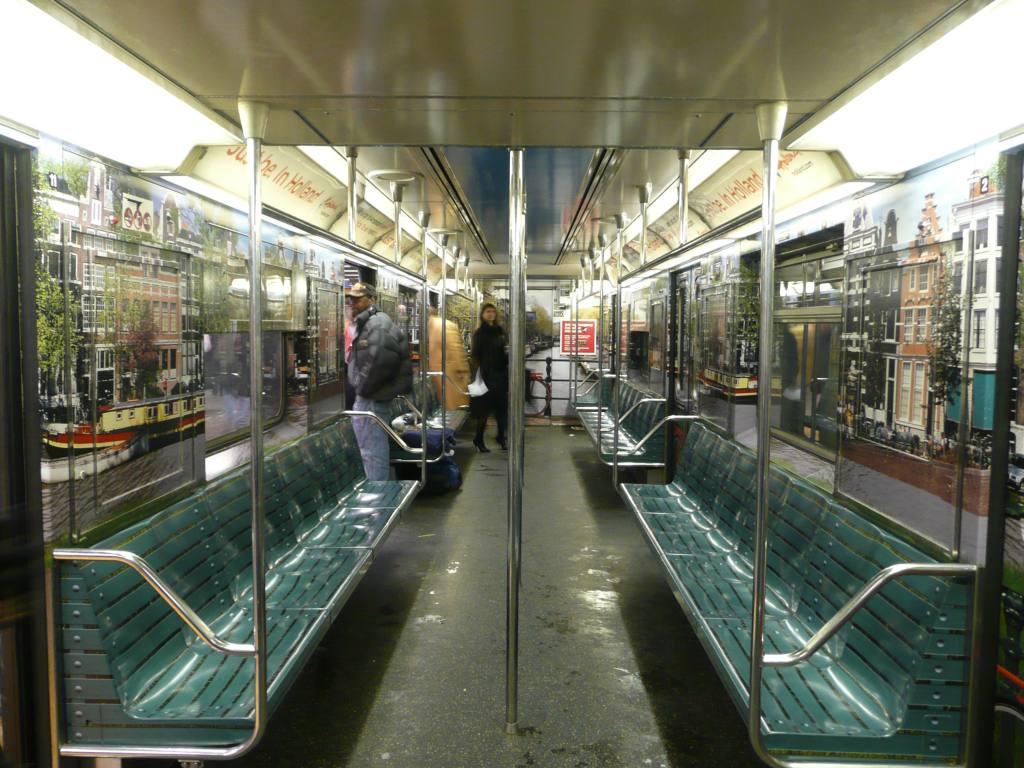 (150k, 1024x768)<br><b>Country:</b> United States<br><b>City:</b> New York<br><b>System:</b> New York City Transit<br><b>Line:</b> IRT Times Square-Grand Central Shuttle<br><b>Location:</b> Times Square <br><b>Route:</b> S<br><b>Car:</b> R-62A (Bombardier, 1984-1987)  1953 <br><b>Photo by:</b> Robbie Rosenfeld<br><b>Date:</b> 2/23/2010<br><b>Notes:</b> Holland travel advertisement.<br><b>Viewed (this week/total):</b> 2 / 1658