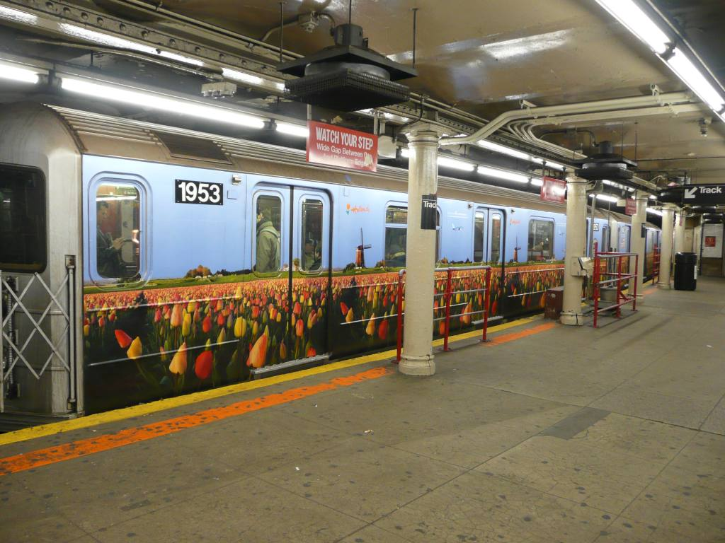 (140k, 1024x768)<br><b>Country:</b> United States<br><b>City:</b> New York<br><b>System:</b> New York City Transit<br><b>Line:</b> IRT Times Square-Grand Central Shuttle<br><b>Location:</b> Times Square <br><b>Route:</b> S<br><b>Car:</b> R-62A (Bombardier, 1984-1987)  1953 <br><b>Photo by:</b> Robbie Rosenfeld<br><b>Date:</b> 2/22/2010<br><b>Notes:</b> Holland travel advertisement.<br><b>Viewed (this week/total):</b> 2 / 1478