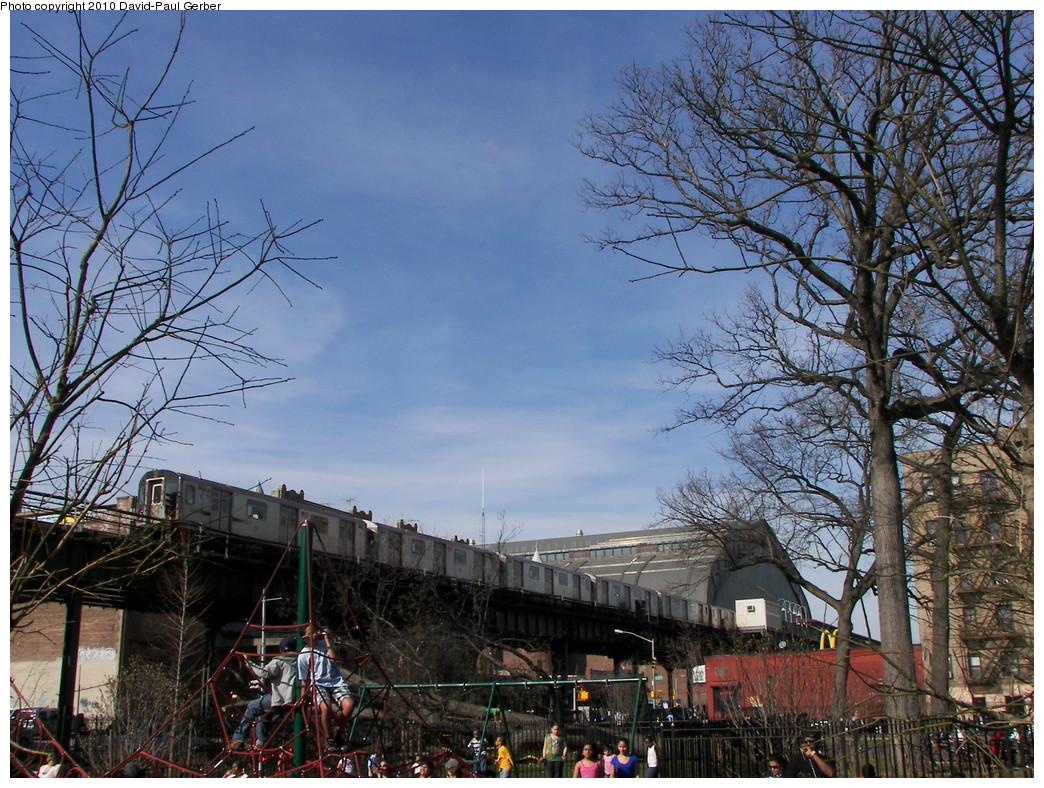 (358k, 1044x788)<br><b>Country:</b> United States<br><b>City:</b> New York<br><b>System:</b> New York City Transit<br><b>Line:</b> IRT Woodlawn Line<br><b>Location:</b> Kingsbridge Road <br><b>Route:</b> 4<br><b>Car:</b> R-142 or R-142A (Number Unknown) 11xx <br><b>Photo by:</b> David-Paul Gerber<br><b>Date:</b> 3/20/2010<br><b>Notes:</b> Inside St. James Park, south of Kingsbridge Road.  Woodlawn-bound train<br><b>Viewed (this week/total):</b> 1 / 1452