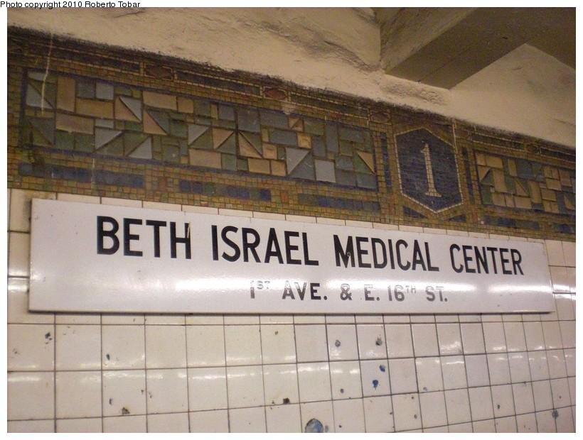 (175k, 820x620)<br><b>Country:</b> United States<br><b>City:</b> New York<br><b>System:</b> New York City Transit<br><b>Line:</b> BMT Canarsie Line<br><b>Location:</b> 1st Avenue <br><b>Photo by:</b> Roberto C. Tobar<br><b>Date:</b> 3/27/2010<br><b>Notes:</b> Mosaic and Beth Israel sign.<br><b>Viewed (this week/total):</b> 4 / 851