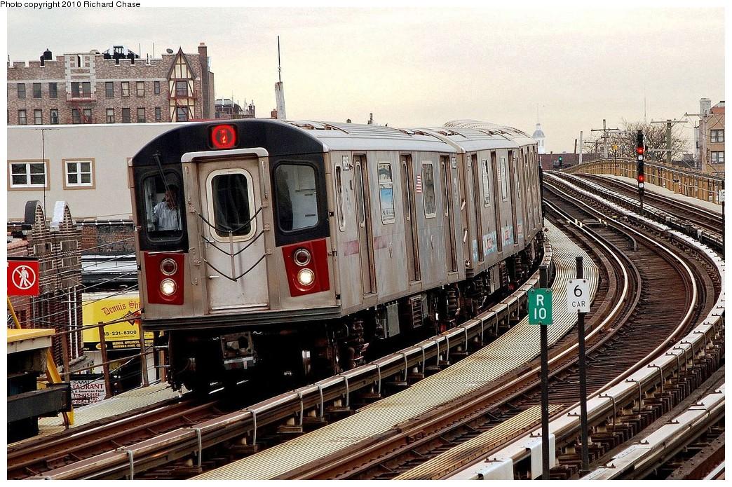 (292k, 1044x695)<br><b>Country:</b> United States<br><b>City:</b> New York<br><b>System:</b> New York City Transit<br><b>Line:</b> IRT White Plains Road Line<br><b>Location:</b> 238th Street (Nereid Avenue) <br><b>Route:</b> 2<br><b>Car:</b> R-142 or R-142A (Number Unknown)  <br><b>Photo by:</b> Richard Chase<br><b>Date:</b> 3/25/2010<br><b>Viewed (this week/total):</b> 0 / 1402