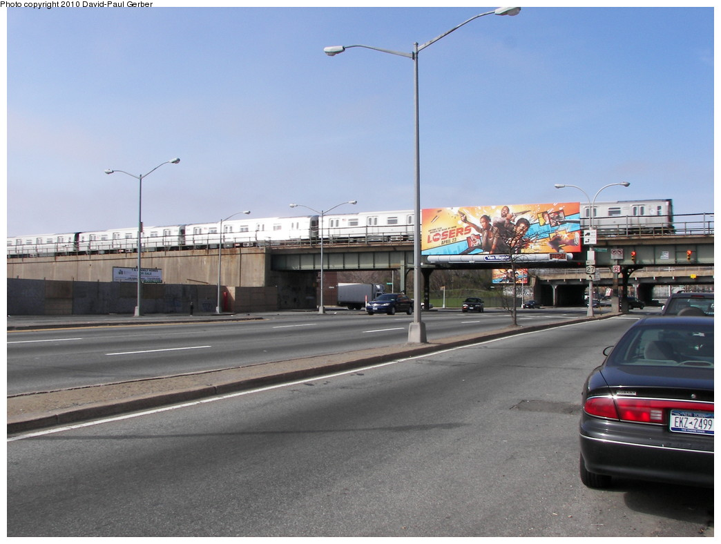 (235k, 1044x788)<br><b>Country:</b> United States<br><b>City:</b> New York<br><b>System:</b> New York City Transit<br><b>Line:</b> BMT Canarsie Line<br><b>Location:</b> New Lots Avenue <br><b>Route:</b> L<br><b>Car:</b> R-143 (Kawasaki, 2001-2002)  <br><b>Photo by:</b> David-Paul Gerber<br><b>Date:</b> 4/3/2010<br><b>Notes:</b> On Linden Blvd at Snediker Ave. Manhattan-bound L train.<br><b>Viewed (this week/total):</b> 6 / 1685