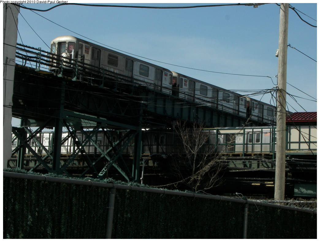 (247k, 1044x788)<br><b>Country:</b> United States<br><b>City:</b> New York<br><b>System:</b> New York City Transit<br><b>Line:</b> BMT Canarsie Line<br><b>Location:</b> Livonia Avenue <br><b>Route:</b> L<br><b>Car:</b> R-143 (Kawasaki, 2001-2002) 8181 <br><b>Photo by:</b> David-Paul Gerber<br><b>Date:</b> 4/3/2010<br><b>Notes:</b> Another way to get the dual 3/L shot - - on Snediker Ave in between buildings and facing L station.<br><b>Viewed (this week/total):</b> 3 / 1324