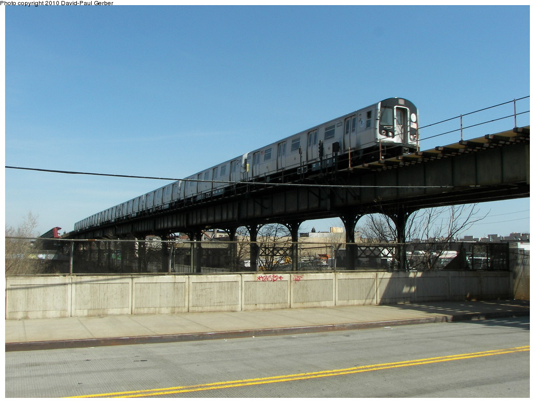 (238k, 1044x788)<br><b>Country:</b> United States<br><b>City:</b> New York<br><b>System:</b> New York City Transit<br><b>Line:</b> BMT Canarsie Line<br><b>Location:</b> Sutter Avenue <br><b>Route:</b> L<br><b>Car:</b> R-143 (Kawasaki, 2001-2002)  <br><b>Photo by:</b> David-Paul Gerber<br><b>Date:</b> 4/3/2010<br><b>Notes:</b> On Blake Ave at Junius Street, one block south of station. Rockaway Parkway-bound train.<br><b>Viewed (this week/total):</b> 0 / 1348