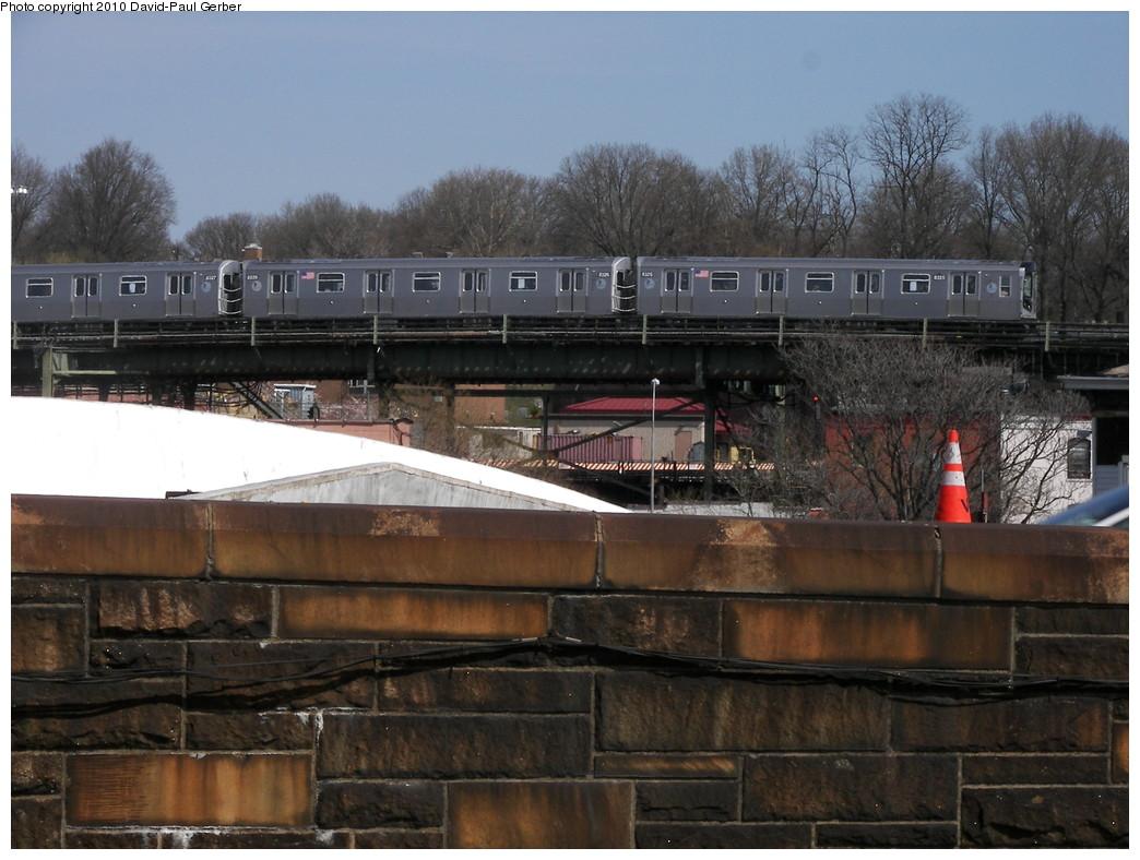 (265k, 1044x788)<br><b>Country:</b> United States<br><b>City:</b> New York<br><b>System:</b> New York City Transit<br><b>Line:</b> BMT Nassau Street/Jamaica Line<br><b>Location:</b> Alabama Avenue <br><b>Photo by:</b> David-Paul Gerber<br><b>Date:</b> 4/3/2010<br><b>Notes:</b> On Atlantic Ave near station entrance with a bird's eye view of Jamaica-Center bound J train traveling towards Alabama Ave.<br><b>Viewed (this week/total):</b> 1 / 775