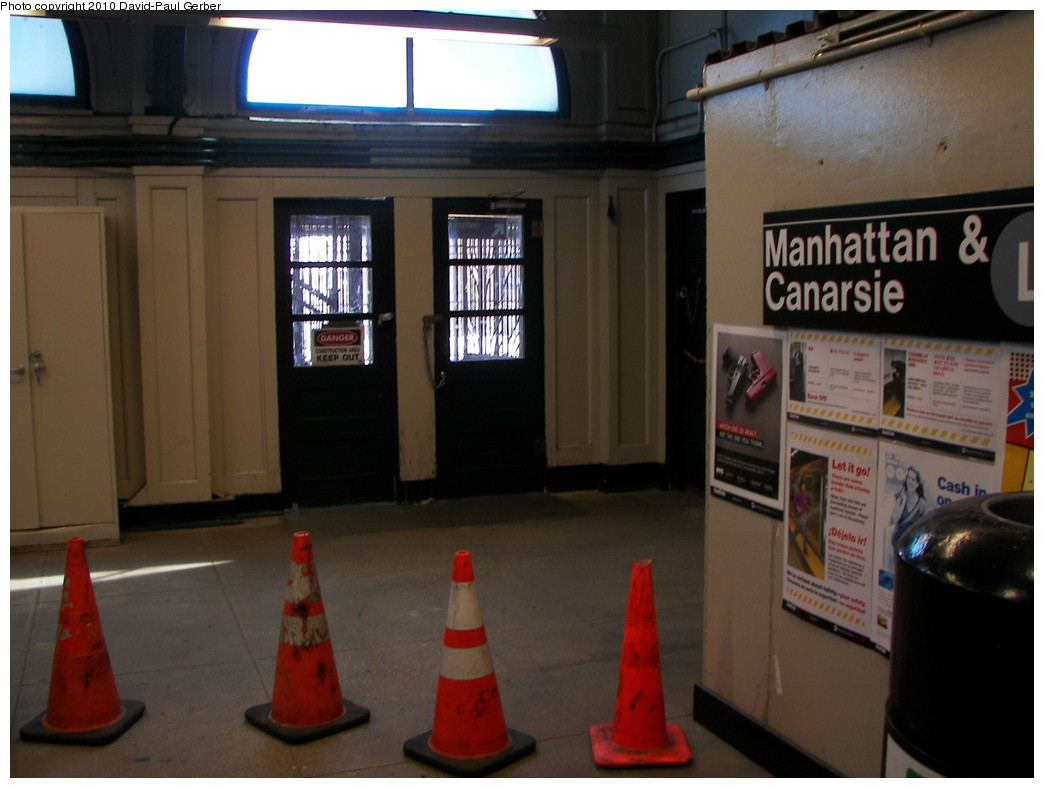 (214k, 1044x788)<br><b>Country:</b> United States<br><b>City:</b> New York<br><b>System:</b> New York City Transit<br><b>Line:</b> BMT Canarsie Line<br><b>Location:</b> Atlantic Avenue <br><b>Photo by:</b> David-Paul Gerber<br><b>Date:</b> 4/3/2010<br><b>Notes:</b> Only traffic cones block this side to former platforms (note sign leading to opposite direction for L service).<br><b>Viewed (this week/total):</b> 0 / 1395