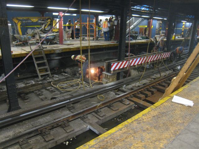 (71k, 640x480)<br><b>Country:</b> United States<br><b>City:</b> New York<br><b>System:</b> New York City Transit<br><b>Line:</b> IRT West Side Line<br><b>Location:</b> 96th Street <br><b>Photo by:</b> David Blair<br><b>Date:</b> 6/19/2010<br><b>Notes:</b> Note workers in passageway under platform.<br><b>Viewed (this week/total):</b> 0 / 2027