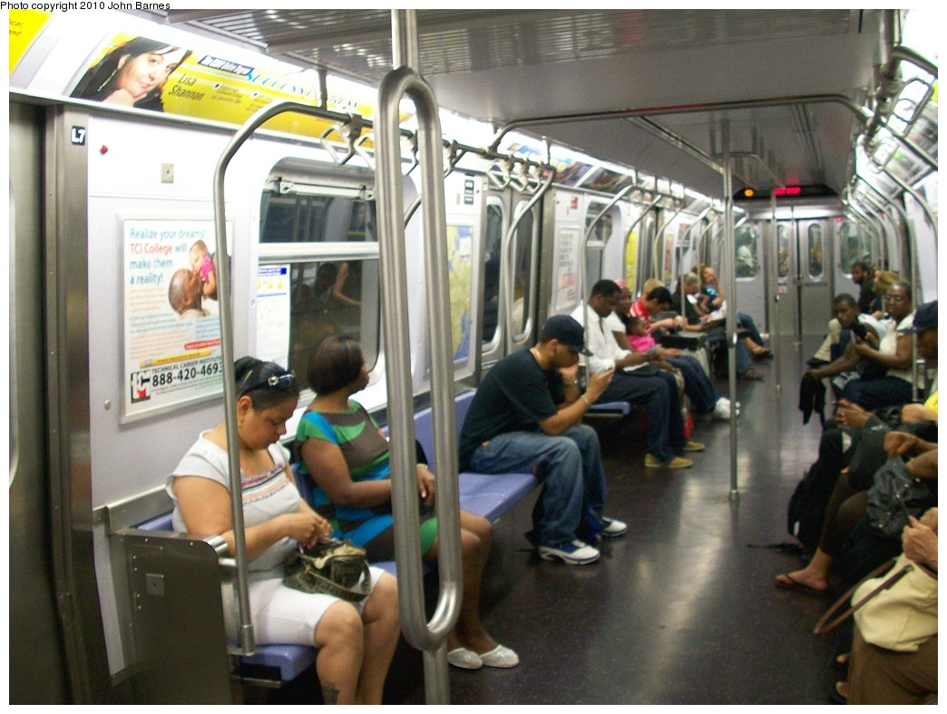 (218k, 1044x788)<br><b>Country:</b> United States<br><b>City:</b> New York<br><b>System:</b> New York City Transit<br><b>Route:</b> E<br><b>Car:</b> R-160B (Kawasaki, 2005-2008)  8714 <br><b>Photo by:</b> John Barnes<br><b>Date:</b> 6/28/2010<br><b>Notes:</b> Interior with experimental flip seats and hand grabs and poles.<br><b>Viewed (this week/total):</b> 0 / 1605