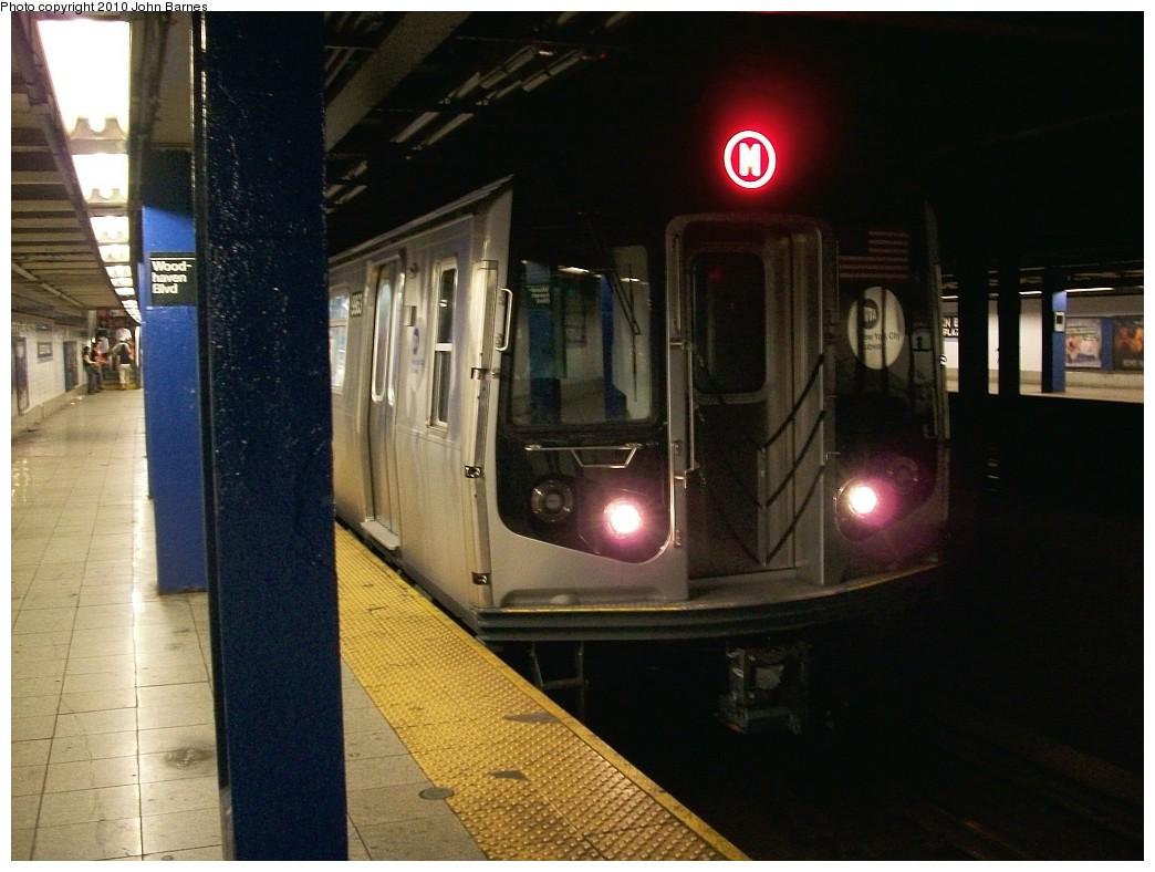 (184k, 1044x788)<br><b>Country:</b> United States<br><b>City:</b> New York<br><b>System:</b> New York City Transit<br><b>Line:</b> IND Queens Boulevard Line<br><b>Location:</b> Woodhaven Boulevard/Queens Mall <br><b>Route:</b> M<br><b>Car:</b> R-160A (Option 2) (Alstom, 2009, 4-car sets)  9963 <br><b>Photo by:</b> John Barnes<br><b>Date:</b> 6/28/2010<br><b>Notes:</b> First day of (M) service to Queens Blvd.<br><b>Viewed (this week/total):</b> 0 / 2267
