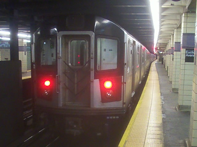 (118k, 640x480)<br><b>Country:</b> United States<br><b>City:</b> New York<br><b>System:</b> New York City Transit<br><b>Line:</b> IND Fulton Street Line<br><b>Location:</b> Euclid Avenue <br><b>Car:</b> R-142A (Option Order, Kawasaki, 2002-2003)  7616 <br><b>Photo by:</b> Christopher Henderson<br><b>Date:</b> 7/15/2010<br><b>Notes:</b> Out of service IRT train being moved to Pitkin Yard - reason unknown.<br><b>Viewed (this week/total):</b> 1 / 1798