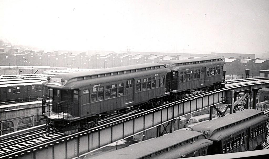 (153k, 1024x605)<br><b>Country:</b> United States<br><b>City:</b> New York<br><b>System:</b> New York City Transit<br><b>Line:</b> BMT Nassau Street/Jamaica Line<br><b>Location:</b> Broadway/East New York (Broadway Junction) <br><b>Car:</b> BMT Elevated Gate Car 749 <br><b>Collection of:</b> George Conrad Collection<br><b>Date:</b> 2/22/1950<br><b>Viewed (this week/total):</b> 0 / 2000