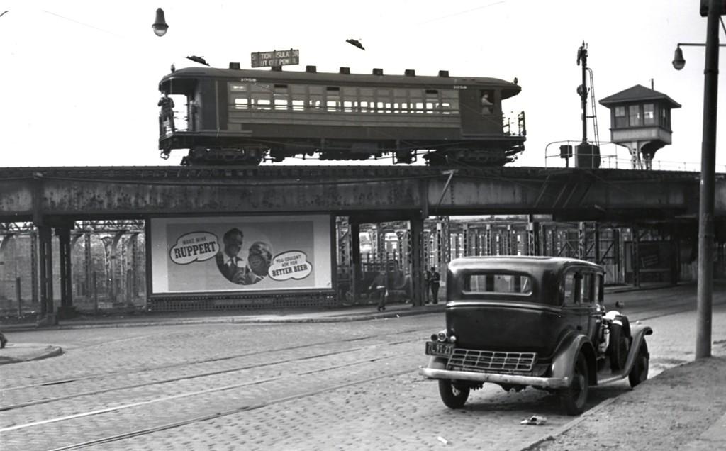 (130k, 1024x636)<br><b>Country:</b> United States<br><b>City:</b> New York<br><b>System:</b> New York City Transit<br><b>Line:</b> BMT 5th Avenue El<br><b>Location:</b> 38th & 5th <br><b>Car:</b> BMT Elevated Gate Car 1038 <br><b>Collection of:</b> George Conrad Collection<br><b>Date:</b> 1939<br><b>Notes:</b> Corner 38th & 5th - facing northeast. Remains of 36th St sidings at rear<br><b>Viewed (this week/total):</b> 2 / 3250