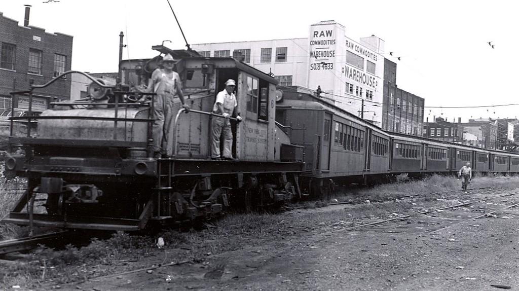 (162k, 1024x574)<br><b>Country:</b> United States<br><b>City:</b> New York<br><b>System:</b> New York City Transit<br><b>Line:</b> South Brooklyn Railway<br><b>Location:</b> 2nd Avenue (SBK)<br><b>Car:</b> SBK Steeplecab 6 <br><b>Collection of:</b> George Conrad Collection<br><b>Date:</b> 7/16/1954<br><b>Notes:</b> SIRT 500 series cars being moved to Coney Island.<br><b>Viewed (this week/total):</b> 1 / 1946