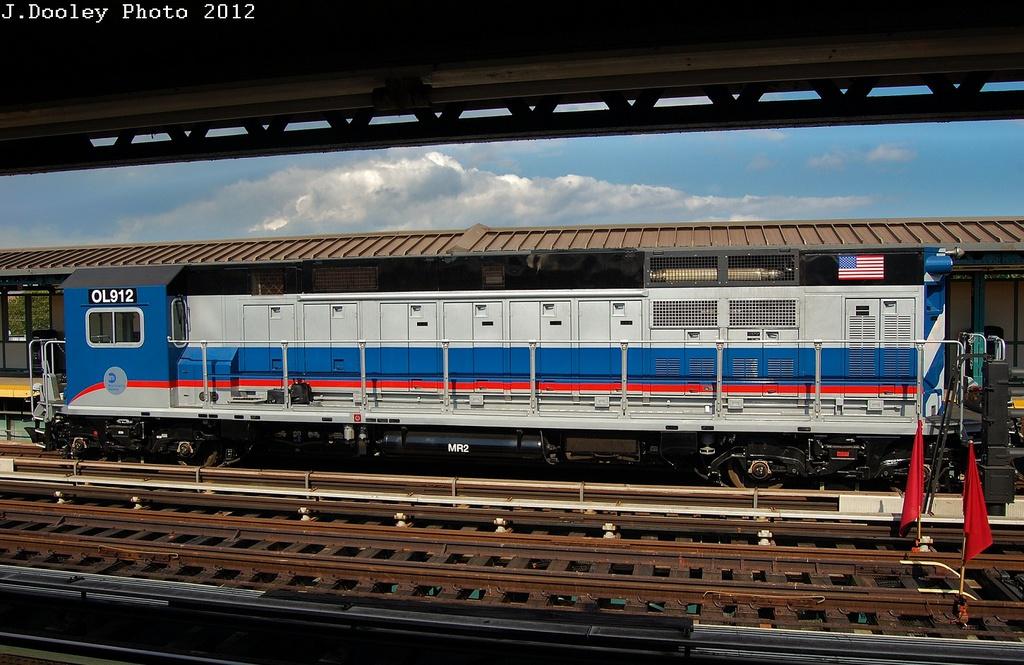 (328k, 1024x665)<br><b>Country:</b> United States<br><b>City:</b> New York<br><b>System:</b> New York City Transit<br><b>Line:</b> BMT West End Line<br><b>Location:</b> Bay 50th Street <br><b>Route:</b> Work Service<br><b>Car:</b> R-156 Diesel-Electric Locomotive (MPI, 2012-2013) 912 <br><b>Photo by:</b> John Dooley<br><b>Date:</b> 7/29/2012<br><b>Viewed (this week/total):</b> 1 / 1261