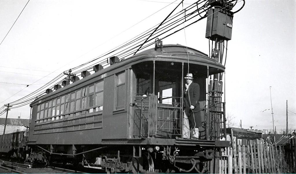 (154k, 1024x602)<br><b>Country:</b> United States<br><b>City:</b> New York<br><b>System:</b> New York City Transit<br><b>Line:</b> BMT Canarsie Line<br><b>Location:</b> Former ROW to Canarsie Pier <br><b>Car:</b> BMT Elevated Gate Car 991 <br><b>Collection of:</b> George Conrad Collection<br><b>Date:</b> 2/6/1939<br><b>Notes:</b> Near Avenue J<br><b>Viewed (this week/total):</b> 2 / 1869
