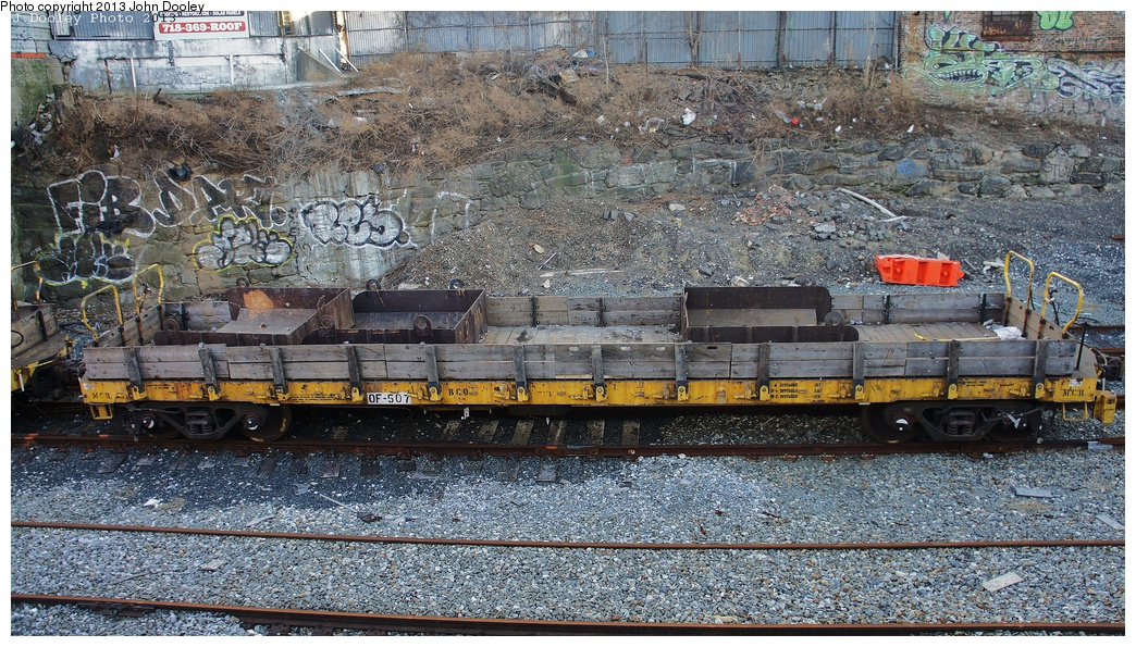 (462k, 1044x595)<br><b>Country:</b> United States<br><b>City:</b> New York<br><b>System:</b> New York City Transit<br><b>Line:</b> South Brooklyn Railway<br><b>Location:</b> 39th St Yard (bet. 4th & 3rd Aves) (SBK)<br><b>Route:</b> Work Service<br><b>Car:</b> Flat Car 507 <br><b>Photo by:</b> John Dooley<br><b>Date:</b> 2/6/2013<br><b>Notes:</b> Delivery of new R-156 OL913 locomotive.<br><b>Viewed (this week/total):</b> 0 / 925