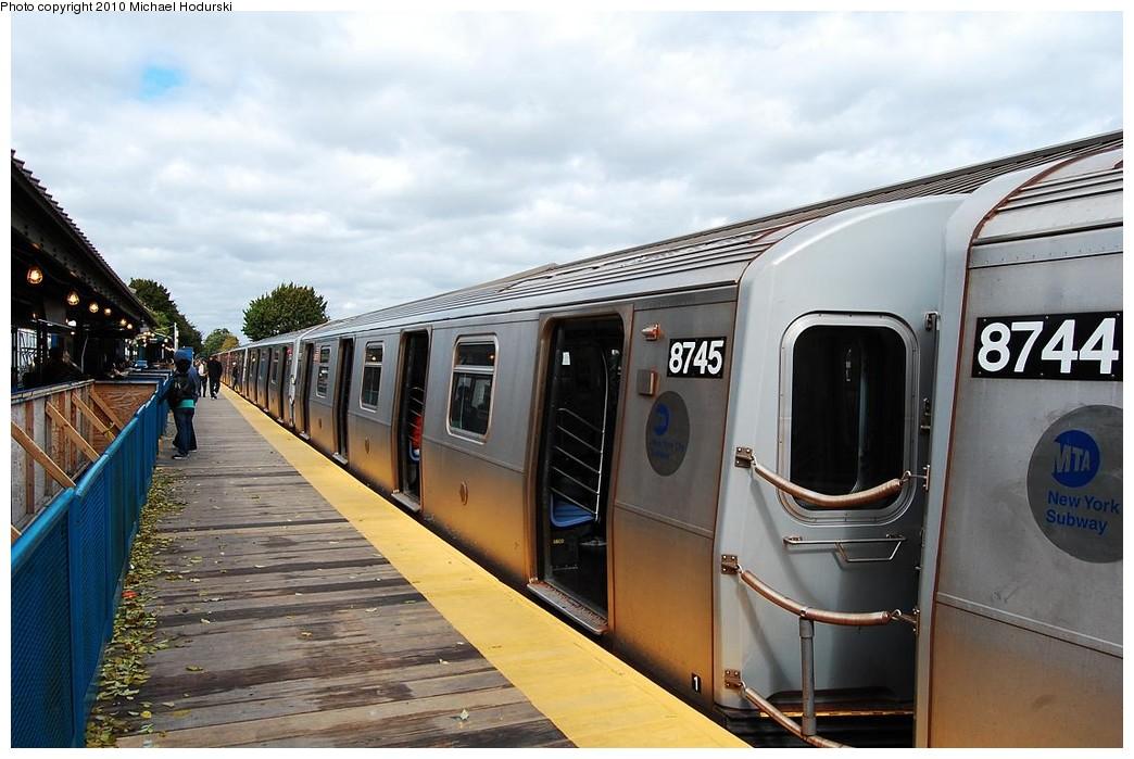 (213k, 1044x699)<br><b>Country:</b> United States<br><b>City:</b> New York<br><b>System:</b> New York City Transit<br><b>Line:</b> BMT Brighton Line<br><b>Location:</b> Kings Highway <br><b>Route:</b> Q<br><b>Car:</b> R-160B (Kawasaki, 2005-2008)  8745 <br><b>Photo by:</b> Michael Hodurski<br><b>Date:</b> 10/15/2010<br><b>Notes:</b> Temporary platform<br><b>Viewed (this week/total):</b> 0 / 919