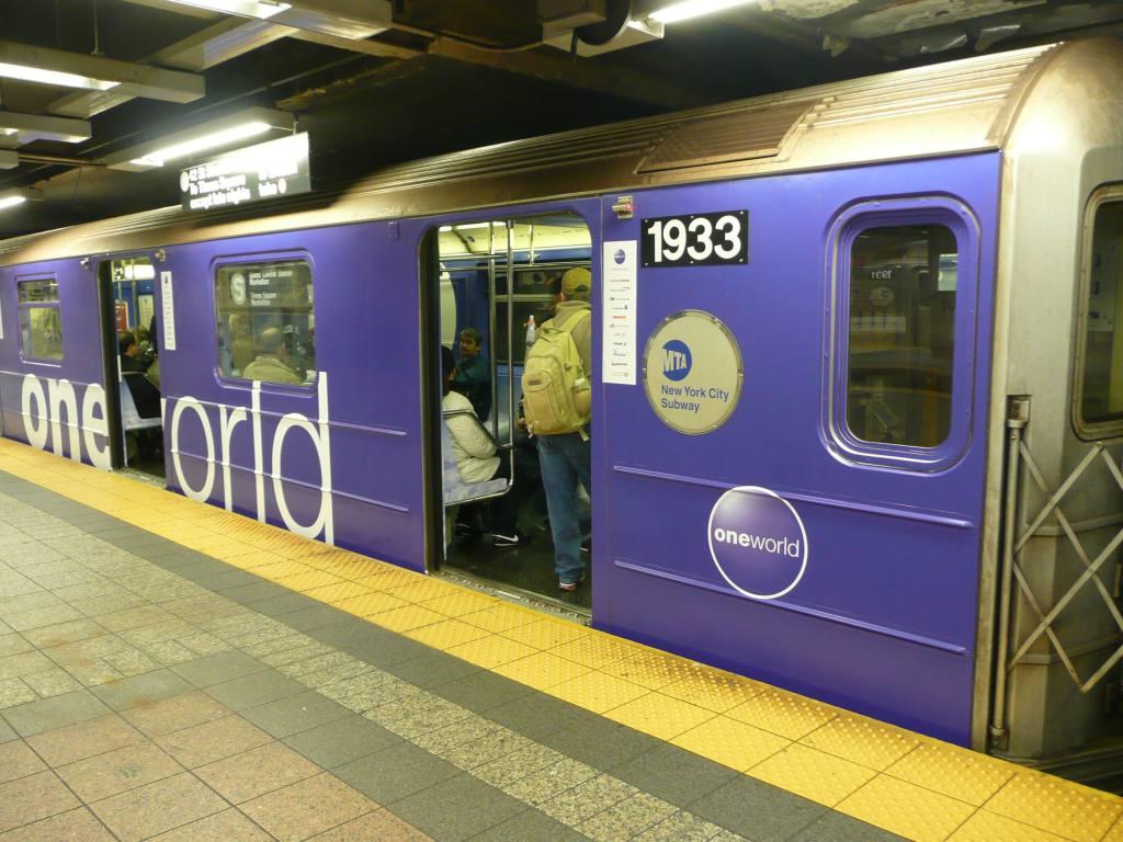 (135k, 1024x768)<br><b>Country:</b> United States<br><b>City:</b> New York<br><b>System:</b> New York City Transit<br><b>Line:</b> IRT Times Square-Grand Central Shuttle<br><b>Location:</b> Grand Central <br><b>Route:</b> S<br><b>Car:</b> R-62A (Bombardier, 1984-1987)  1933 <br><b>Photo by:</b> Robbie Rosenfeld<br><b>Date:</b> 10/4/2010<br><b>Notes:</b> Oneworld airlines ad wrap.<br><b>Viewed (this week/total):</b> 0 / 771