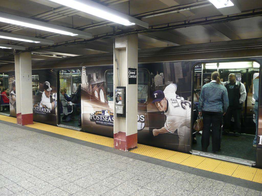 (142k, 1024x768)<br><b>Country:</b> United States<br><b>City:</b> New York<br><b>System:</b> New York City Transit<br><b>Line:</b> IRT Times Square-Grand Central Shuttle<br><b>Location:</b> Grand Central <br><b>Route:</b> S<br><b>Car:</b> R-62A (Bombardier, 1984-1987)   <br><b>Photo by:</b> Robbie Rosenfeld<br><b>Date:</b> 10/4/2010<br><b>Notes:</b> TBS baseball ad wrap.<br><b>Viewed (this week/total):</b> 0 / 895