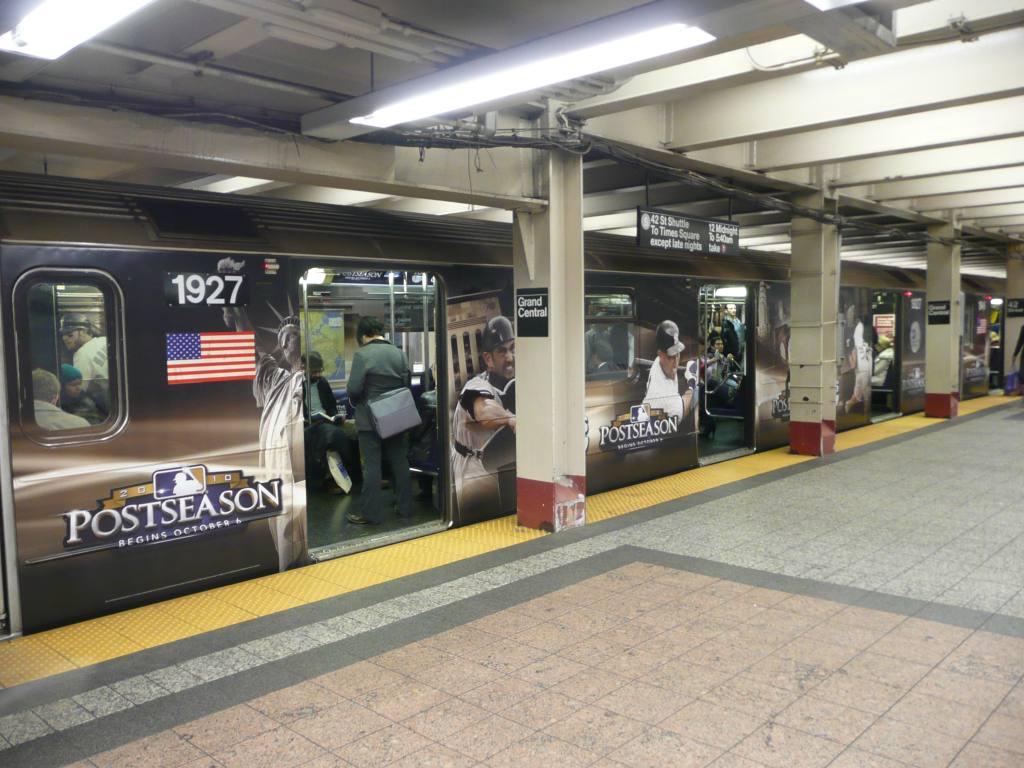 (134k, 1024x768)<br><b>Country:</b> United States<br><b>City:</b> New York<br><b>System:</b> New York City Transit<br><b>Line:</b> IRT Times Square-Grand Central Shuttle<br><b>Location:</b> Grand Central <br><b>Route:</b> S<br><b>Car:</b> R-62A (Bombardier, 1984-1987)  1927 <br><b>Photo by:</b> Robbie Rosenfeld<br><b>Date:</b> 10/4/2010<br><b>Notes:</b> TBS baseball ad wrap.<br><b>Viewed (this week/total):</b> 1 / 902
