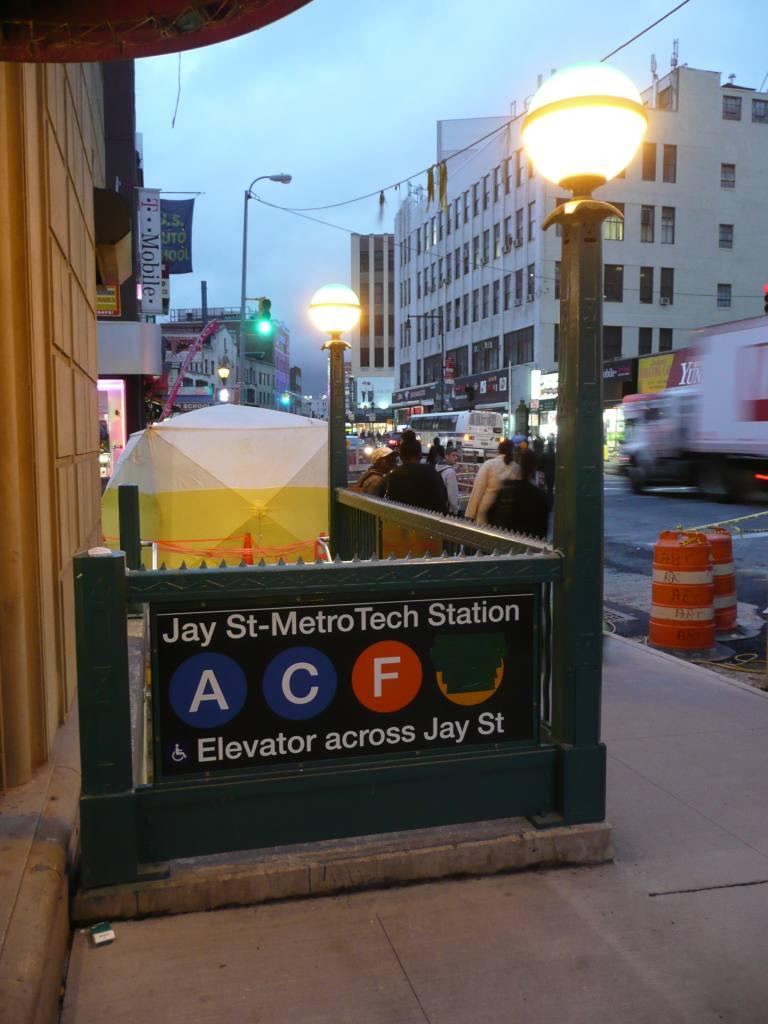 (96k, 768x1024)<br><b>Country:</b> United States<br><b>City:</b> New York<br><b>System:</b> New York City Transit<br><b>Line:</b> IND 8th Avenue Line<br><b>Location:</b> Jay St./Metrotech (Borough Hall) <br><b>Photo by:</b> Robbie Rosenfeld<br><b>Date:</b> 10/5/2010<br><b>Notes:</b> New Jay St-Metrotech signs.<br><b>Viewed (this week/total):</b> 1 / 2202
