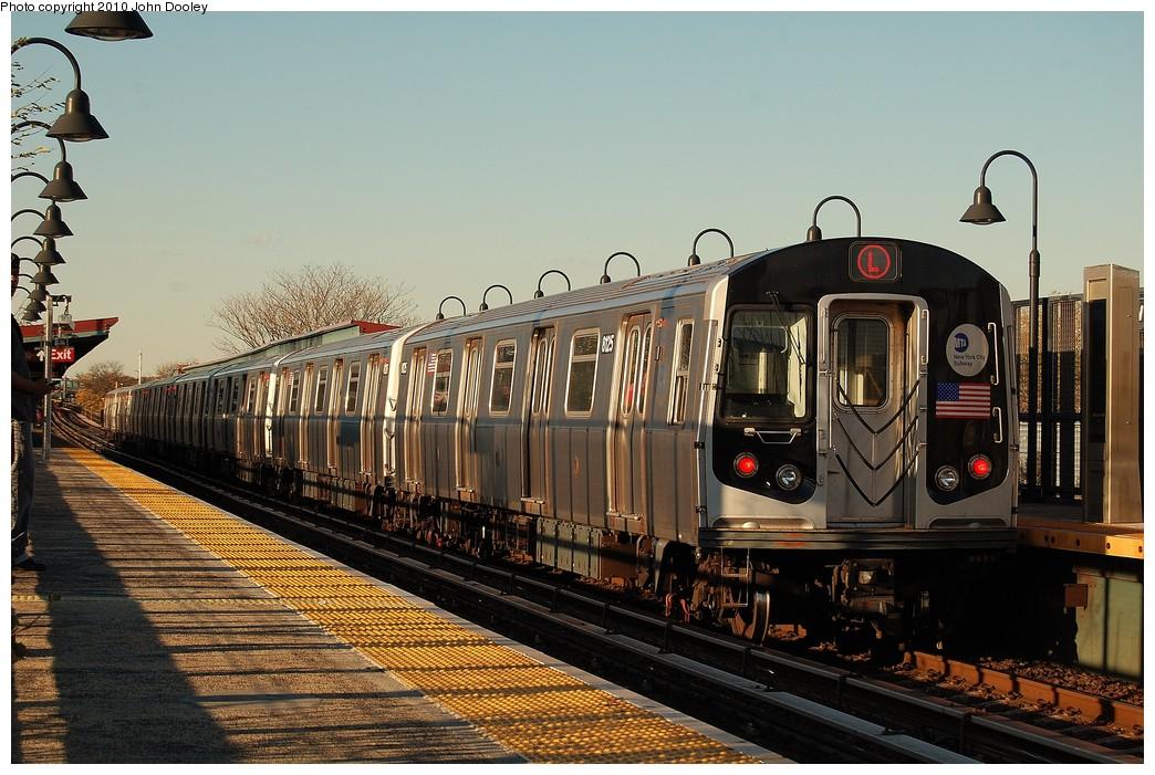 (257k, 1044x701)<br><b>Country:</b> United States<br><b>City:</b> New York<br><b>System:</b> New York City Transit<br><b>Line:</b> BMT Canarsie Line<br><b>Location:</b> Sutter Avenue <br><b>Route:</b> L<br><b>Car:</b> R-143 (Kawasaki, 2001-2002) 8125 <br><b>Photo by:</b> John Dooley<br><b>Date:</b> 10/28/2010<br><b>Viewed (this week/total):</b> 2 / 1082