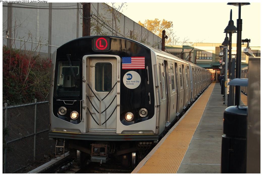 (237k, 1044x701)<br><b>Country:</b> United States<br><b>City:</b> New York<br><b>System:</b> New York City Transit<br><b>Line:</b> BMT Canarsie Line<br><b>Location:</b> East 105th Street <br><b>Route:</b> L<br><b>Car:</b> R-143 (Kawasaki, 2001-2002) 8313 <br><b>Photo by:</b> John Dooley<br><b>Date:</b> 10/28/2010<br><b>Viewed (this week/total):</b> 0 / 1093