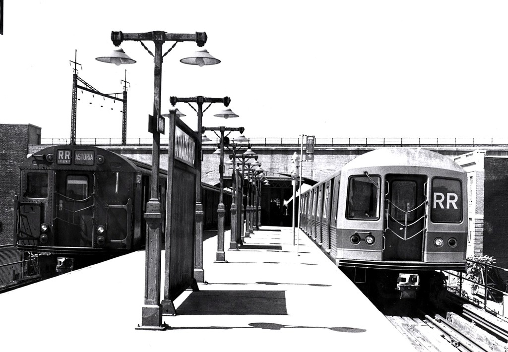 (153k, 1024x710)<br><b>Country:</b> United States<br><b>City:</b> New York<br><b>System:</b> New York City Transit<br><b>Line:</b> BMT Astoria Line<br><b>Location:</b> Ditmars Boulevard <br><b>Route:</b> RR<br><b>Car:</b> R-42 (St. Louis, 1969-1970)   <br><b>Collection of:</b> George Conrad Collection<br><b>Date:</b> 6/28/1970<br><b>Notes:</b> With R27/R30 train on left.<br><b>Viewed (this week/total):</b> 2 / 2649
