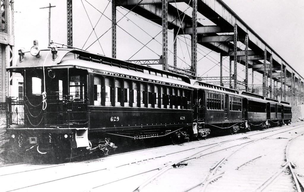(193k, 1024x648)<br><b>Country:</b> United States<br><b>City:</b> New York<br><b>System:</b> New York City Transit<br><b>Line:</b> South Brooklyn Railway<br><b>Location:</b> 39th St Yard (bet. 4th & 3rd Aves) (SBK)<br><b>Car:</b> BMT Elevated Gate Car 629-644-643 <br><b>Collection of:</b> George Conrad Collection<br><b>Date:</b> 1905<br><b>Notes:</b> 5th Avenue El above.<br><b>Viewed (this week/total):</b> 2 / 1515