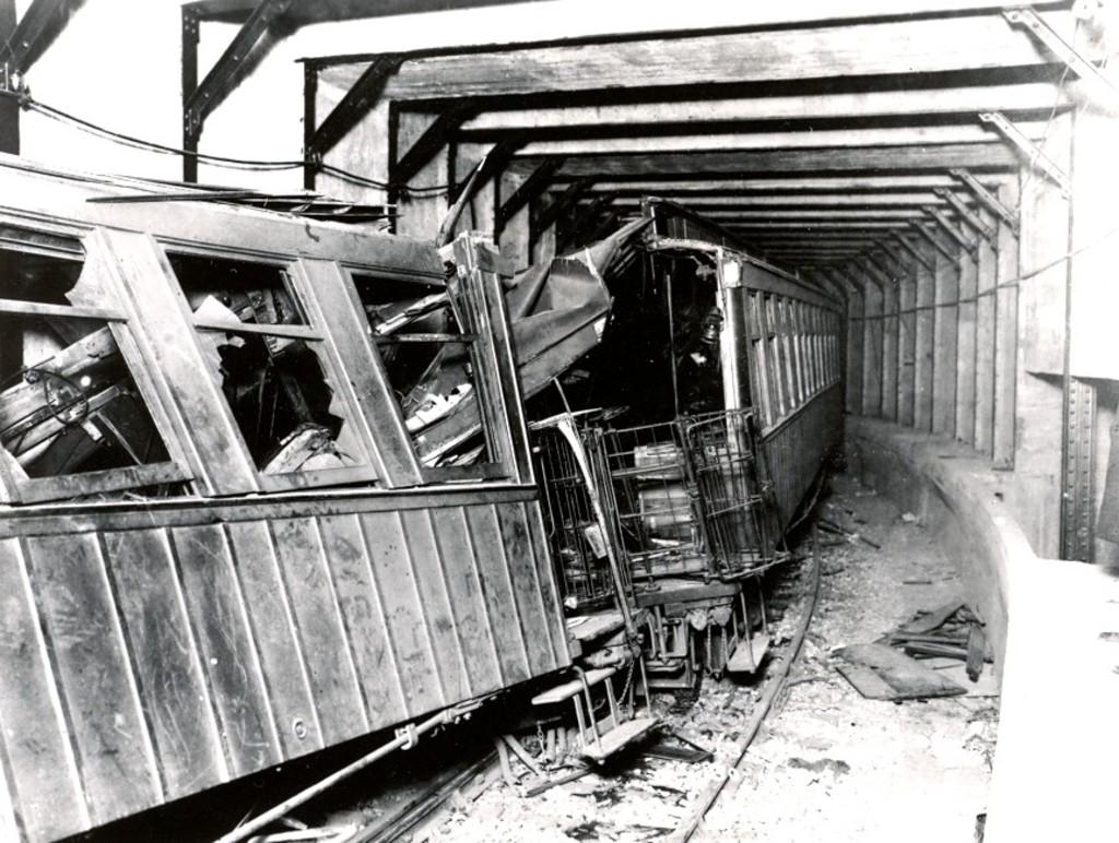(214k, 1024x772)<br><b>Country:</b> United States<br><b>City:</b> New York<br><b>System:</b> New York City Transit<br><b>Line:</b> BMT Franklin<br><b>Location:</b> Empire Blvd. (Malbone St.) Tunnel Portal <br><b>Car:</b> BMT Elevated Gate Car 100/80 <br><b>Collection of:</b> George Conrad Collection<br><b>Date:</b> 11/2/1918<br><b>Notes:</b> 3rd and 2nd cars in Malbone St. wreck.<br><b>Viewed (this week/total):</b> 11 / 7204