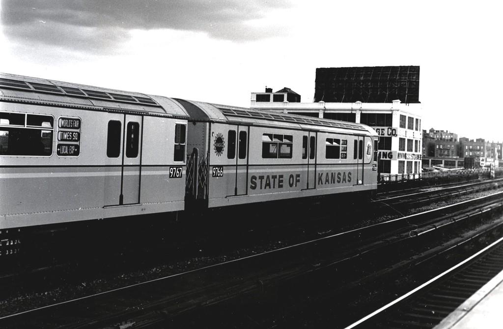 (130k, 1024x669)<br><b>Country:</b> United States<br><b>City:</b> New York<br><b>System:</b> New York City Transit<br><b>Line:</b> IRT Flushing Line<br><b>Location:</b> 33rd Street/Rawson Street <br><b>Route:</b> 7<br><b>Car:</b> R-36 World's Fair (St. Louis, 1963-64) 9766 <br><b>Collection of:</b> George Conrad Collection<br><b>Date:</b> 10/10/1964<br><b>Notes:</b> State of Kansas car.<br><b>Viewed (this week/total):</b> 0 / 2473