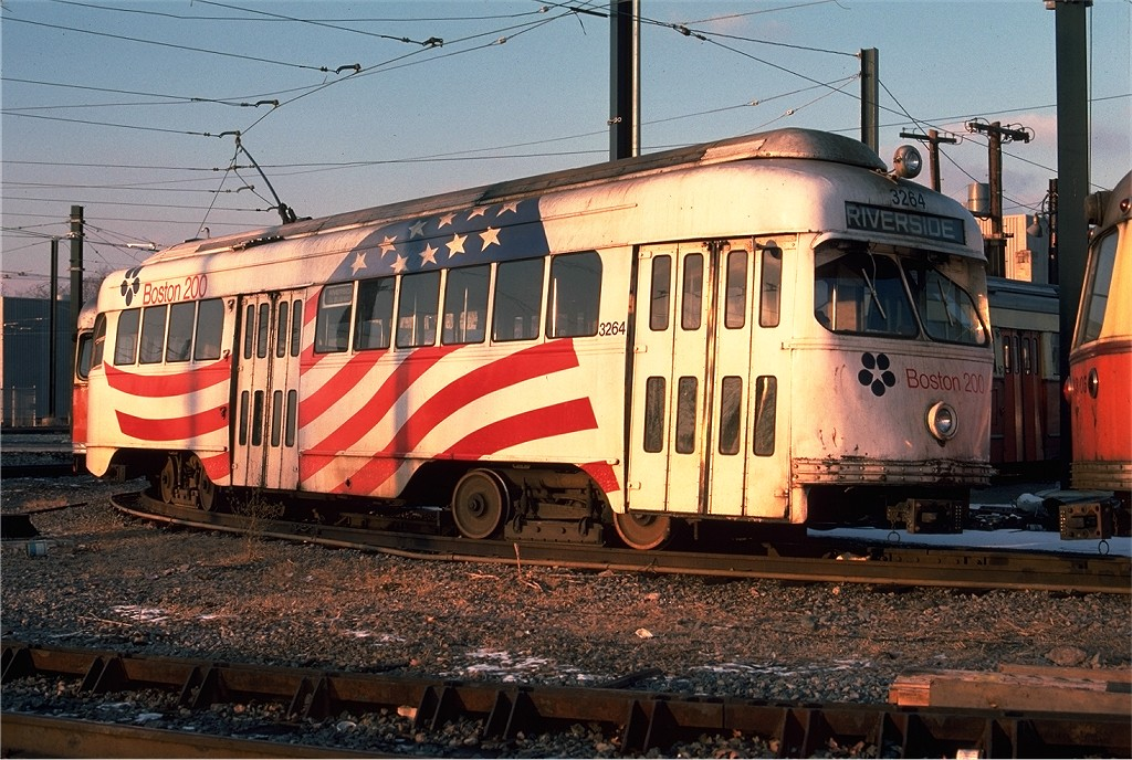 (242k, 1024x688)<br><b>Country:</b> United States<br><b>City:</b> Boston, MA<br><b>System:</b> MBTA<br><b>Line:</b> MBTA Green (D)<br><b>Location:</b> Riverside Yard <br><b>Car:</b> MBTA/BSRy PCC Wartime (Pullman-Standard, 1945-46)  3264 <br><b>Photo by:</b> Ed McKernan<br><b>Collection of:</b> Joe Testagrose<br><b>Date:</b> 12/5/1976<br><b>Viewed (this week/total):</b> 1 / 365