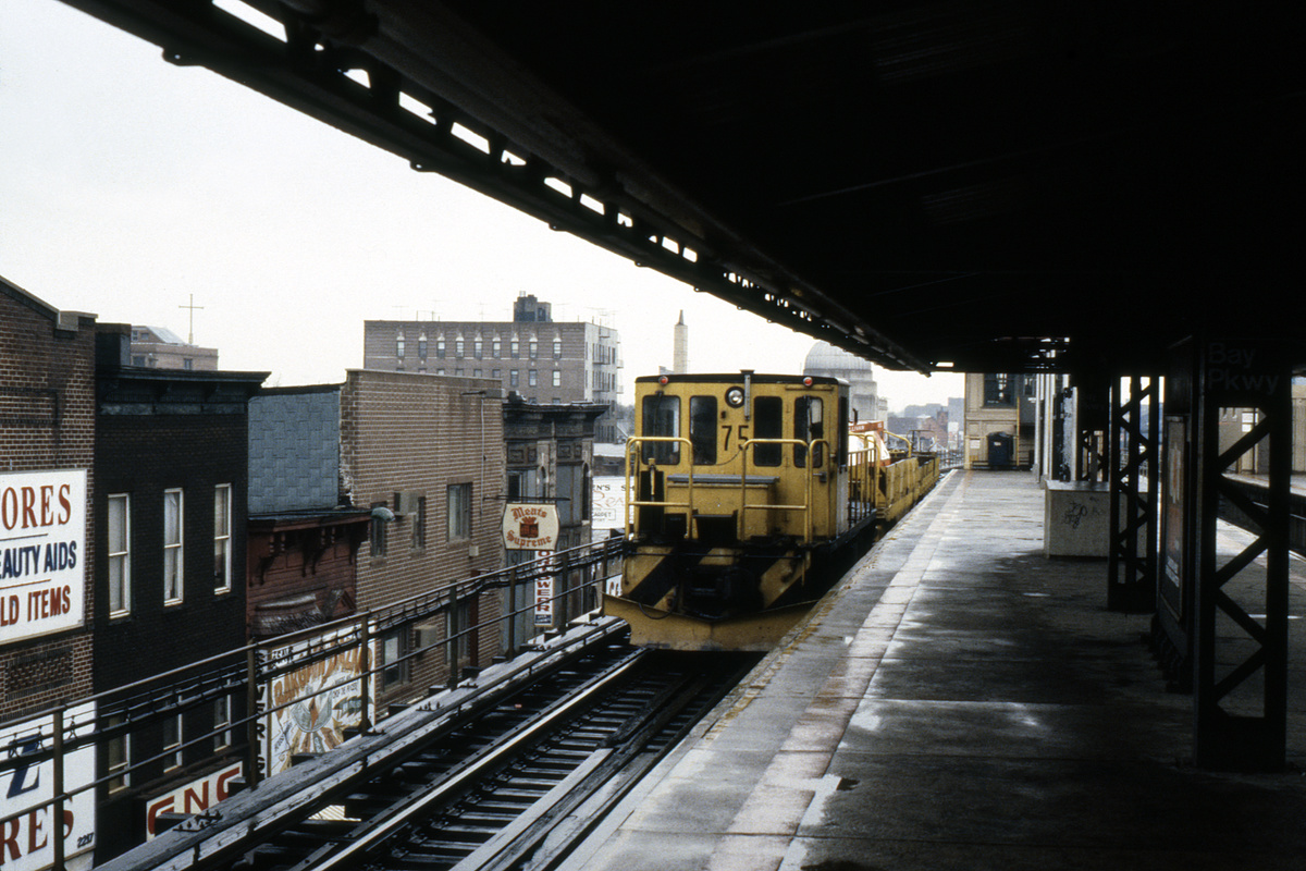 (254k, 1024x685)<br><b>Country:</b> United States<br><b>City:</b> New York<br><b>System:</b> New York City Transit<br><b>Line:</b> BMT West End Line<br><b>Location:</b> Bay Parkway <br><b>Car:</b> R-52 Locomotive  75 <br><b>Collection of:</b> Collection of nycsubway.org <br><b>Notes:</b> 1980s<br><b>Viewed (this week/total):</b> 0 / 1161