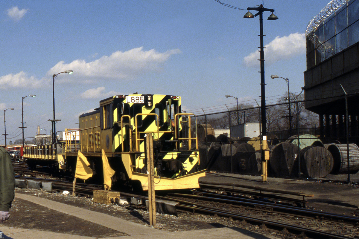 (264k, 1024x689)<br><b>Country:</b> United States<br><b>City:</b> New York<br><b>System:</b> New York City Transit<br><b>Location:</b> 36th Street Yard<br><b>Car:</b> R-77 Locomotive  885 <br><b>Collection of:</b> Collection of nycsubway.org <br><b>Notes:</b> 1980s<br><b>Viewed (this week/total):</b> 3 / 957