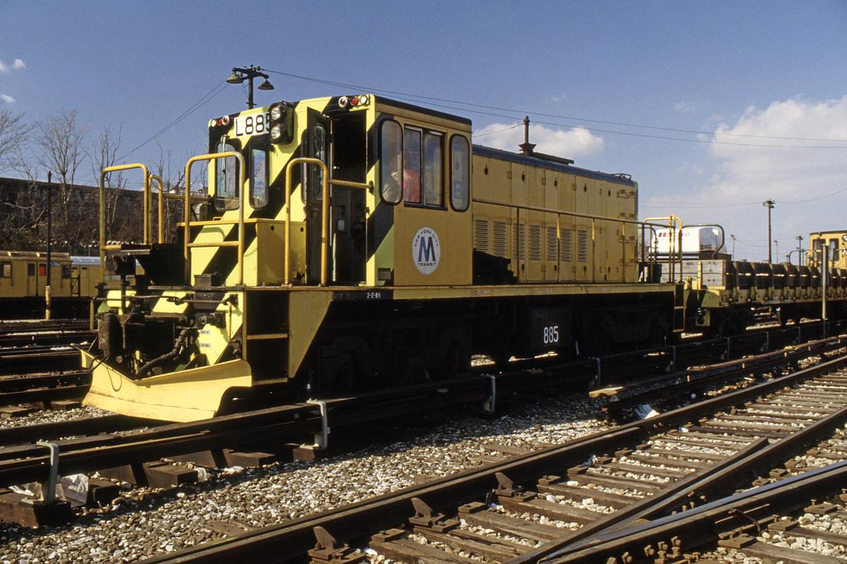(464k, 1024x683)<br><b>Country:</b> United States<br><b>City:</b> New York<br><b>System:</b> New York City Transit<br><b>Location:</b> 36th Street Yard<br><b>Car:</b> R-77 Locomotive  885 <br><b>Collection of:</b> Collection of nycsubway.org <br><b>Notes:</b> 1980s<br><b>Viewed (this week/total):</b> 2 / 1067