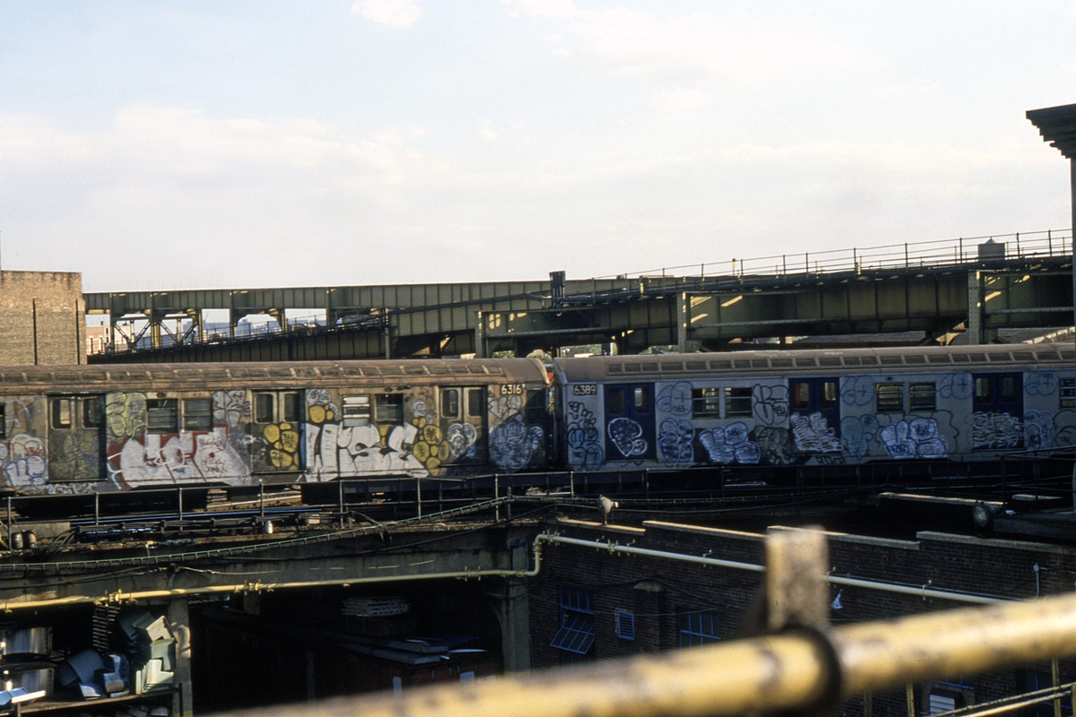 (281k, 1024x683)<br><b>Country:</b> United States<br><b>City:</b> New York<br><b>System:</b> New York City Transit<br><b>Location:</b> East New York Yard/Shops<br><b>Car:</b> R-16 (American Car & Foundry, 1955) 6316/6389 <br><b>Collection of:</b> Collection of nycsubway.org <br><b>Notes:</b> 1980s<br><b>Viewed (this week/total):</b> 4 / 3887