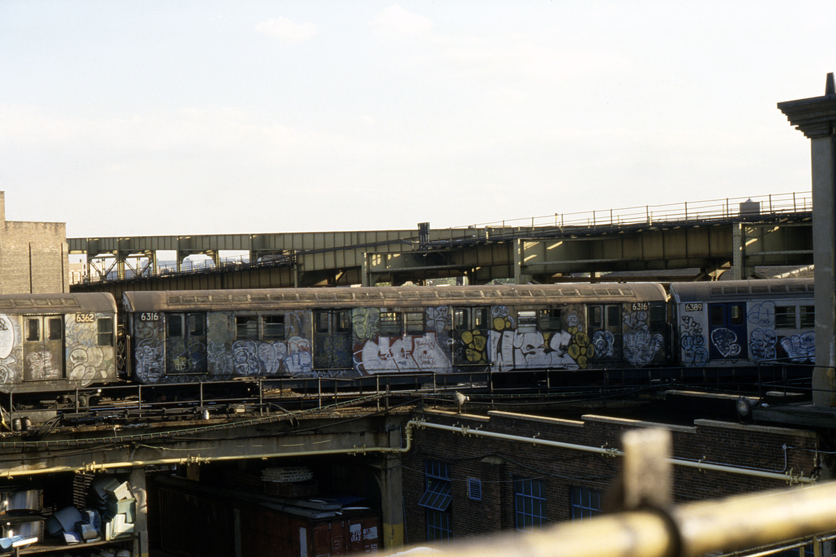(332k, 1024x683)<br><b>Country:</b> United States<br><b>City:</b> New York<br><b>System:</b> New York City Transit<br><b>Location:</b> East New York Yard/Shops<br><b>Car:</b> R-16 (American Car & Foundry, 1955) 6362/6316/6389 <br><b>Collection of:</b> Collection of nycsubway.org <br><b>Notes:</b> 1980s<br><b>Viewed (this week/total):</b> 1 / 3084