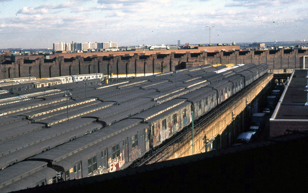 (307k, 1049x657)<br><b>Country:</b> United States<br><b>City:</b> New York<br><b>System:</b> New York City Transit<br><b>Location:</b> East New York Yard/Shops<br><b>Car:</b> R-7 (American Car & Foundry, 1937)  1402 <br><b>Photo by:</b> Todd Glickman<br><b>Date:</b> 1976<br><b>Notes:</b> R-9 types in East New York Yard.<br><b>Viewed (this week/total):</b> 2 / 1038