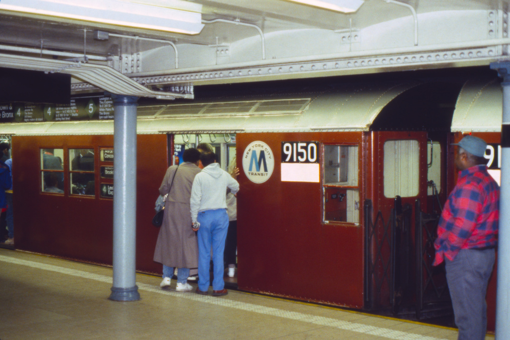 (251k, 1024x687)<br><b>Country:</b> United States<br><b>City:</b> New York<br><b>System:</b> New York City Transit<br><b>Line:</b> IRT East Side Line<br><b>Location:</b> Fulton Street <br><b>Route:</b> 4<br><b>Car:</b> R-33 Main Line (St. Louis, 1962-63) 9150 <br><b>Collection of:</b> Collection of nycsubway.org <br><b>Notes:</b> 1980s<br><b>Viewed (this week/total):</b> 1 / 3081