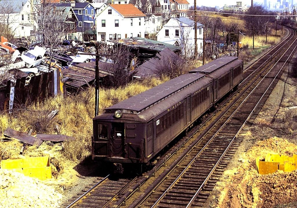 (371k, 1024x719)<br><b>Country:</b> United States<br><b>City:</b> New York<br><b>System:</b> New York City Transit<br><b>Line:</b> SIRT<br><b>Location:</b> Grasmere <br><b>Car:</b> SIRT ME-1 (Motor) 328 <br><b>Collection of:</b> George Conrad Collection<br><b>Notes:</b> View from Narrows Rd just north of Grasmere looking north<br><b>Viewed (this week/total):</b> 1 / 2341