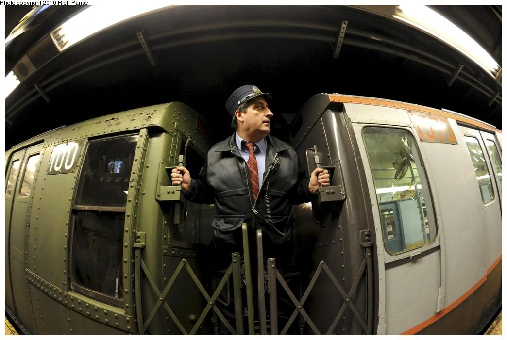 (163k, 1044x701)<br><b>Country:</b> United States<br><b>City:</b> New York<br><b>System:</b> New York City Transit<br><b>Line:</b> IND Queens Boulevard Line<br><b>Location:</b> Queens Plaza <br><b>Route:</b> Fan Trip<br><b>Car:</b> R-1 (American Car & Foundry, 1930-1931) 100 <br><b>Photo by:</b> Richard Panse<br><b>Date:</b> 12/5/2010<br><b>Notes:</b> With 1575 and Conductor.<br><b>Viewed (this week/total):</b> 0 / 1347