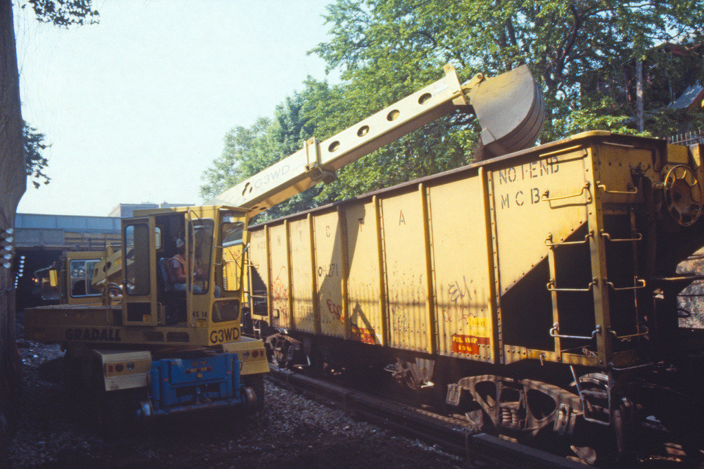 (270k, 1024x678)<br><b>Country:</b> United States<br><b>City:</b> New York<br><b>System:</b> New York City Transit<br><b>Line:</b> BMT Brighton Line<br><b>Location:</b> Avenue H <br><b>Route:</b> Work Service<br><b>Car:</b> R-23 MoW Hopper (1958, Marshall Rwy. Equip. Co.)  271 <br><b>Collection of:</b> Collection of nycsubway.org <br><b>Date:</b> 5/18/1986<br><b>Notes:</b> Ballast work<br><b>Viewed (this week/total):</b> 4 / 1543